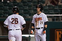 Fresno Grizzlies third baseman JD Davis (21) congratulates Tim Federowicz (26) after hitting a home run during a Pacific Coast League game against the Salt Lake Bees at Chukchansi Park on May 14, 2018 in Fresno, California. Fresno defeated Salt Lake 4-3. (Zachary Lucy/Four Seam Images)