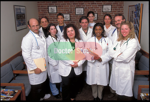 group portrait of doctors standing with charts