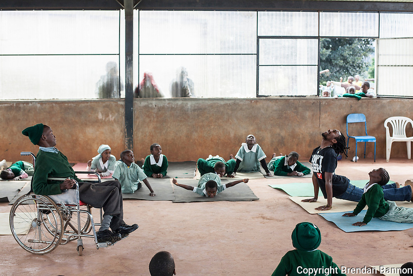 Yoga teachers from Africa Yoga Project teach yoga to special needs students in Dagoretti on the outskirts of Nairobi, Kenya.