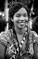 """milano, manifestazione euro mayday parade 2007. """"qual'è la tua condizione economica/lavorativa?""""  MARTA, 22 anni, studente biotecnologie ambientali. padre dello zimbabwe, madre italiana. """"Se sei studente puoi assumere due atteggiamenti: negativo (non troverò mai.un lavoro a contratto indeterminato e sarò sfruttata per due soldi e per.l'illusione di poter ottenere il posto fisso) o positivo (ho fiducia nelle.mie capacità e quello che studio e quello che sono mi porteranno ad ottenere.ciò che voglio nella vita!). Il fatto è che in italia le opportunità sono.poche....ma personalmente preferisco credere nella seconda. Per quanto.riguarda l'indipendenza economica questo mi spaventa meno perchè in.lombardia di lavori (per quanto saltuari e infami) se ne trovano a pacchi."""" --- milan, euro mayday parade 2007 demonstration. """"How is your economic and working condition?""""  MARTA, 22, student in environmental biotechnology. father from zimbabwe, mother from italy. """"If you are student you can take two attitudes: negative (I will never find a job with permanent contract and I will be exploited for a few pennies and for the illusion of finally obtaining the regular job) or positive (I trust my skills and what I'm studying and what I am will take me to what I want in life!). The fact is that in italy opportunities are few...but personally I prefer to believe in the second one. For what concerns economical independence this scares me less because in Lombardy you can find lots of jobs (even if casual and infamous)."""""""