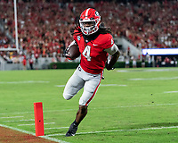 ATHENS, GA - SEPTEMBER 18: James Cook #4 makes a reception and runs for a touchdown during a game between South Carolina Gamecocks and Georgia Bulldogs at Sanford Stadium on September 18, 2021 in Athens, Georgia.