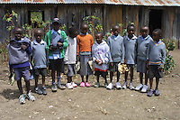 In Matanya, a small rural East African village in Kenya - located near the base of Mount Kenya, students gather outside of their old wood planked, dirt floored school wearing shoes donated by Matanya's Hope donors from the USA.  They are clutching sweaters, shirts, and other items such as underwear, socks, a bed, blanket, soap, and toothbrush that are donated by the charity to the neediest children in Kenya.