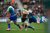 Danny Care of Harlequins is tackled by Andrew Browne of Connacht Rugby during the Heineken Cup match between Harlequins and Connacht Rugby at The Twickenham Stoop on Saturday 12th January 2013 (Photo by Rob Munro).