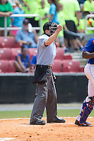 Home plate umpire Sam Dodson makes a strike call during the Appalachian League game between the Greeneville Astros and the Kingsport Mets at Hunter Wright Stadium on July 7, 2015 in Kingsport, Tennessee.  The Mets defeated the Astros 6-4. (Brian Westerholt/Four Seam Images)