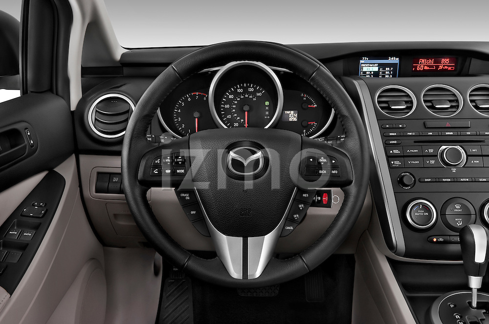 Steering wheel view of a 2010 Mazda CX7i Sport