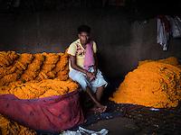 The whole sale Flower Market near the Howrah Bridge at Calcutta (Kolkata) in West Bengal in India.