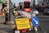 Covid-19 pandemic., London.  Kilburn High Road narrowed to aid pedestrian social distancing.