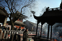 CHINA. Scene during Chinese New Year in Baiyun Temple in Beijing.  Chinese New Year, or Spring Festival, is the most important festival and holiday in the Chinese calendar In mainland China, many people use this holiday to visit family and friends and also visit local temples to offer prayers to their ancestors. The roots of Chinese New Year lie in combined influences from Buddhism, Taoism, Confucianism, and folk religions.  2008.