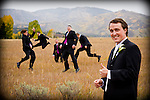 Groom and his men jumping in a field in Steamboat Springs Colorado.