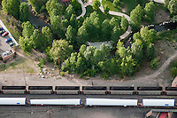 Coal train, alongside wind tower parts shipped. Pueblo, Colorado. May 2012