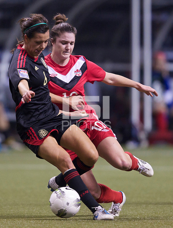 Christina Julien, right, of Canada and Natalie Garcia Mendez battle for the ball in the CONCACAF Olympic Qualifying semifinal match at BC Place in Vancouver, B.C., Canada Friday Jan. 27, 2012. Canada won the match 3-1 to earn a berth in 2012 London Olympics.
