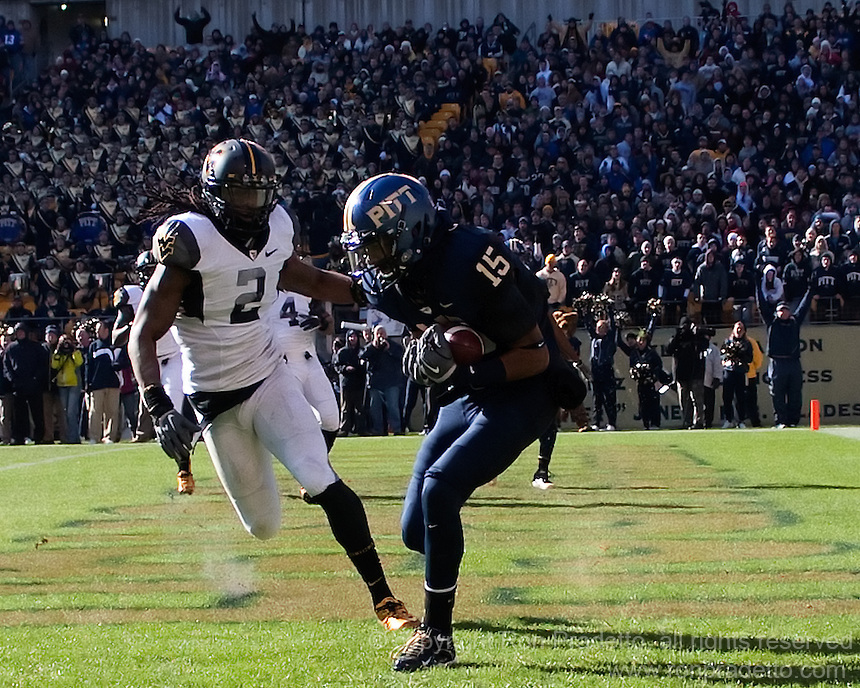 Pitt wide receiver Devin Street makes a 8-yard touchdown catch as WVU defensive back Robert Sands (2) looks on. The WVU Mountaineers defeated the Pitt Panthers 35-10 at Heinz Field, Pittsburgh, Pennsylvania on November 26, 2010.