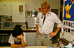 NHS 1980s Doctor Phil Hammond and Dr Lynn Surname, she is exhausted late at night in the Special care unit. Royal United Hospital Bath Hospital Somerset 1989 U