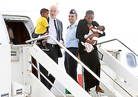 La sudanese Meriam Yahia Ibrahim Isha sbarca con la figlia Maya in braccio ed il figlio Martin in braccio al Viceministro degli Esteri Lapo Pistelli, a sinistra, dopo essere atterrata da Khartoum all'aeroporto militare di Ciampino, Roma, 24 luglio 2014. La giovane cristiana condannata a morte all'ottavo mese di gravidanza in Sudan, per apostasia e poi liberata, e' arrivata in Italia con i figli ed il marito, con un volo della presidenza del Consiglio, accompagnata da Pistelli.<br /> Meriam Yahia Ibrahim Isha disembarks with her daughter Maya in her arms and her son Martin in the arms of Italian deputy Foreign Minister Lapo Pistelli, left, after landing from Khartoum at Ciampino's military airport, on the outskirts of Rome, 24 July 2014. The Sudanese christian woman who was sentenced to death in Sudan for apostasy, has arrived in Italy with her children and her husband by an Italian government's aircraft, accompanied by Pistelli.<br /> UPDATE IMAGES PRESS/Riccardo De Luca