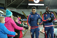 (L-R) Neil Taylor and Marvin Emnes of Swansea arrive before the Barclays Premier League match between Swansea City and Watford at the Liberty Stadium, Swansea on January 18 2016