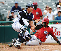 Trenton Thunder catcher Jose Gil (36) tries to block home plate as Altoona Curve base runner Mel Rojas Jr. (3) scores during game played at ARM & HAMMER Park on July 24, 2013 in Trenton, NJ.  Altoona defeated Trenton 4-2.  Tomasso DeRosa/Four Seam Images