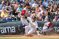 J.B. Shuck (30) of the Charlotte Knights slides into third base as Rio Ruiz (24) of the Gwinnett Braves waits for a throw at BB&T BallPark on May 22, 2016 in Charlotte, North Carolina.  The Knights defeated the Braves 9-8 in 11 innings.  (Brian Westerholt/Four Seam Images)
