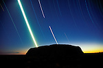 Eight-hour timed exposure traces the moon's path over Uluru