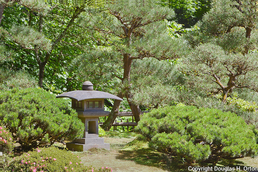 Concrete Lantern in Garden.  Japanese Garden, Portland, Oregon.  The Japanese Garden in Portland is a 5.5 acre respit.  Said to be one of the most authentic Japanese Garden's outside of Japan, the rolling terrain and water features symbolize both peace and strength.