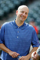 Atlanta Braves Assistant General Manager John Coppolella talks around the batting cage before a Spring Training game against the New York Yankees on Wednesday, March 18, 2015, at Champion Stadium at the ESPN Wide World of Sports Complex in Lake Buena Vista, Florida. The Yankees won, 12-5. (Tom Priddy/Four Seam Images)