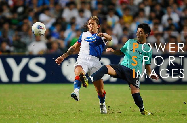 SO KON PO, HONG KONG - JULY 30: Miguel Salgado of Blackburn Rovers and Chan Man Fai of Kitchee in action during the Asia Trophy pre-season friendly match at the Hong Kong Stadium on July 30, 2011 in So Kon Po, Hong Kong.  Photo by Victor Fraile / The Power of Sport Images