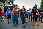 Spectators and competitors dance as The Cave Singers perform during the Epic Rides' Inaugural Carson City Off-Road event on Saturday, June 18, 2016 in Carson City, Nev.<br /> Photo by Kevin Clifford/Nevada Photo Source
