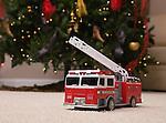 USA, Illinois, Metamora, toy truck under Christmas tree