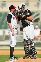 Pitcher Kevin Moran #31 has a chat on the mound with catcher Mike Blanke #32 during the South Atlantic League game against the Hagerstown Suns at Fieldcrest Cannon Stadium on May 30, 2011 in Kannapolis, North Carolina.   Photo by Brian Westerholt / Four Seam Images