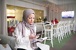 2A92TBP Young woman with smartphone in office