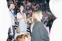 People listen from the stands during a speech at the Democratic National Convention at the Wells Fargo Center in Philadelphia, Pennsylvania, on Wed., July 27, 2016.  People listen from the stands during a speech at the Democratic National Convention at the Wells Fargo Center in Philadelphia, Pennsylvania, on Wed., July 27, 2016.