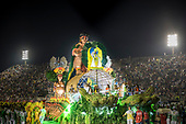 Imperatriz Leopolinense Samba School, Carnival, Rio de Janeiro, Brazil, 26th February 2017. Float carrying the Indians from the Alto Xingu Indigenous Park with a representation of an Oca house under construction, a pregnant Indian woman and a man sitting on top of the Oca to show the indigenous cultures as living and vigorous.