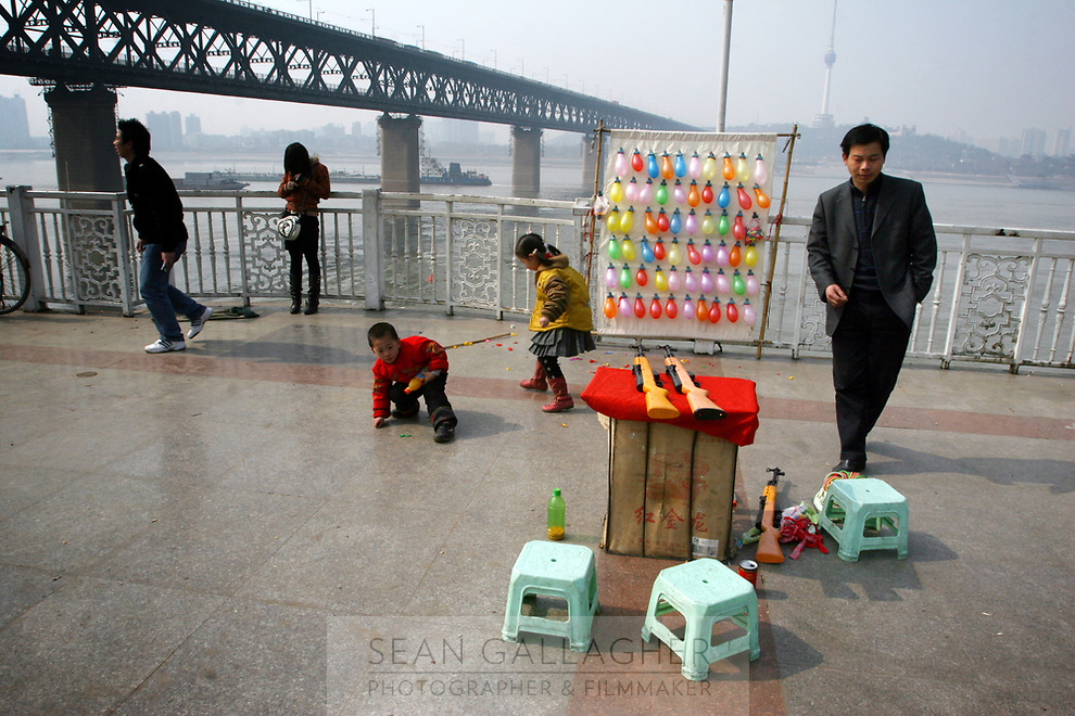 CHINA. Hubei Province. Wuhan. A games stall near to the Yangtze River. Wuhan (population 4.3 million) is a sprawling city that sits on both sides of the Yangtze River. Its trade has been inextricably linked with the Yangtze river for centuries. The Yangtze River is reported to be at its lowest level in 150 years as a result of a country-wide drought. It is China's longest river and the third longest in the world. Originating in Tibet, the river flows for 3,964 miles (6,380km) through central China into the East China Sea at Shanghai.  2008