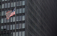 26 JUN 2014 - CHICAGO, USA - The Stars and Stripes, the flag of the USA, flies in front of a building in the lead up to the July the 4th Independence Day celebrations in Chicago in the USA (PHOTO COPYRIGHT © 2014 NIGEL FARROW, ALL RIGHTS RESERVED)