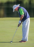 Former NFL player Jim McMahon putts in the final round of the American Century Championship at Edgewood Tahoe Golf Course in Stateline, Nev., on Sunday, July 19, 2015. <br /> Photo by Cathleen Allison