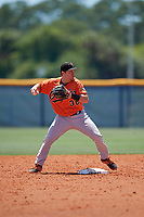 Baltimore Orioles second baseman John Ham (36) throws to first base attempting to turn a double play during a Minor League Extended Spring Training game against the Tampa Bay Rays on April 17, 2019 at Charlotte County Sports Complex in Port Charlotte, Florida.  (Mike Janes/Four Seam Images)