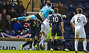 Dundee keeper Kyle Letheren is injured as he god over the top of Raith Rovers' Reece Donaldson.