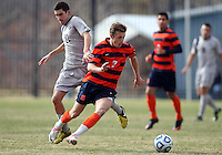 WASHINGTON, DC - NOVEMBER 25, 2012: John Snyder (22) of Georgetown University looses the ball to Louis Clark (7) of Syracuse University during an NCAA championship third round match at North Kehoe field, in Georgetown, Washington DC on November 25. Georgetown won 2-1 after overtime and penalty kicks.