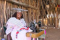 Herero Lady sewing souvenirs near Kamanjab, Namibia