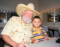 06 July 2020 - Country music and southern rock legend Charlie Daniels has passed away after suffering a stroke. The Grand Ole Opry member and Country Music Hall of Famer was 83. File Photo: August 15, 2008 - Alpharetta, GA - Charlie Daniels met fans of all ages and signed autographs backstage at the Charlie Daniels Volunteer Jam at Verizon Wireless Amphitheater. Photo Credit: Dan Harr/AdMedia