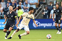 KANSAS CITY, KS - JUNE 26: Carlos Vela #10 Los Angeles FC with the ball during a game between Los Angeles FC and Sporting Kansas City at Children's Mercy Park on June 26, 2021 in Kansas City, Kansas.