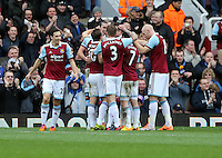 Pictured: Kevin Nolan of West Ham is mobbed by team mates celebrating his second goal. 01 February 2014<br /> Re: Barclay's Premier League, West Ham United v Swansea City FC at Boleyn Ground, London.