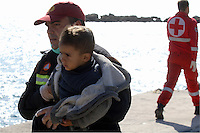 Pictured: A member of the emergency services is carrying a young boy to safety Thursday 27 November 2014<br />