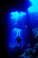Scuba divers explore the lava tubes and geologic formations of Pupukea, also known as Shark's Cove. It is a marine life conservation park located on the north shore of Oahu.