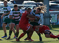 Jordy Reid of Ealing Trailfinders is tackled by Ziana Alexis of Jersey Reds during the Greene King IPA Championship match between Ealing Trailfinders and Jersey at Castle Bar, West Ealing, England  on 19 October 2019. Photo by Alan Stanford / PRiME Media Images