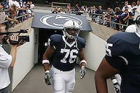 State College, PA - 9/16/2006 - Penn State offensive linemen Gerald Cadogan (76) runs onto the field before the game on September 16, 2006, at Beaver Stadium.  The Nittany Lions defeated Youngstown State 37-3...Joe Rokita / JoeRokita.com