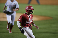 Arkansas infielder Jalen Battles (4) scores, Saturday, June 5, 2021 during the sixth inning in the second game of the NCAA Fayetteville Regional at Baum-Walker Stadium in Fayetteville. Check out nwaonline.com/210606Daily/ for today's photo gallery. <br /> (NWA Democrat-Gazette/Charlie Kaijo)