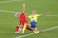 YOKOHAMA, JAPAN - AUGUST 6: Adriana Leon #9 of Canada battles for the ball with Nathalie Bjorn #14 of Sweden during a game between Canada and Sweden at International Stadium Yokohama on August 6, 2021 in Yokohama, Japan.