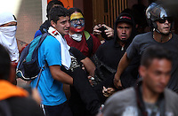 Venezuela: Caracas,12/02/14 <br /> Students carries a corp of Basil Alexander Da Costa Frias, who fall injured with a gunshot wound to the head during the student protests of February 12, in the vicinity of the Attorney General of Venezuela, in center Caracas. Da Costa Vargas died in the hospital, a few minutes laterEdsau Olivares//Archivolatino