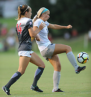 NWA Democrat-Gazette/ANDY SHUPE<br /> Penn State's Frannie Crouse (right) redirects the ball away from Arkansas' Reid Sibley Friday, Aug. 25, 2017, during the Razorbacks' 4-2 loss at Razorback Field in Fayetteville. Visit nwadg.com/photos to see more photographs from the match.