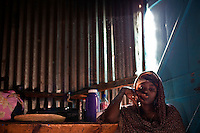 "Jawahir.""I was born in Mogadishu.  ..I fled Mogadishu because of war.  I was there during the war, but then it came too close -I lost my husband.  ..I went first to Afgooye - I was there for one and a half months.  There's a very big problem because there is no water and very little food.  There's no help.  .We ran away to Afgooye - that's how we became safe.  ..Three of my children died, they were caught in the crossfire.  They were fleeing from fighting, but they got caught.  This happened just before we left.  .We came seeking peace and we found it.  We had only Hargeysa in our minds.  ..Inside Mogadishu, we used to run from one place to another to keep safe.  .We would move at dawn with the children walking from place to place.  .If you want to know how your friends are in Mogadishu, you go to a phone booth and call them.  It's impossibly dangerous to visit them.  ..After the Ethiopians left, things divided along tribal lines, they're fighting among themselves - the names they give themselves is just to hide the clan. ..So many innocent people are living in Mogadishu.  Every day a number of them die and they're not the ones fighting.  ..They go out to look for daily bread, they die.  ..Somebody must go out and look for food and water.  It's luck.  If they come back we eat.  .It's very sad when kids lose their parents. The parents go out sometimes and never come back. ..Days later the children leave the house to look for them and they get lost and maybe that's their end.  Every day, people are leaving but still there are people living in Mogadishu.  .I feel very bad because the war has touched me, it's touched my kids.  Now we are here - I don't know how I would cope without the help of my neighbors.  ..I was isolated because I could go to see loved ones and they couldn't come to me.  Everyone lives the same in Mogadishu.  ..Now that I have peace, I have lost hope of going back to Mogadishu.  In the future, I want to stay and work here. I would love for my childr"